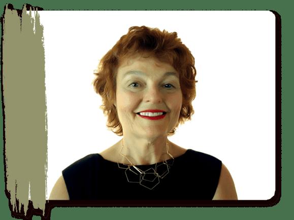Psychic Business Coach Deborah J. Dakota headshot wearing gold geometric necklace